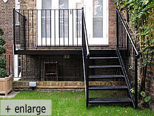 a small metal staircase and platform/balcony all completed with handrails and balustrade for safety.